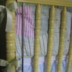 tied ribbon around the crib posts for a fuller look