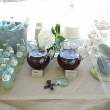 Drink table.  A vintage Brownie camera was the perfect weight for paper plates.