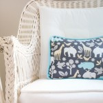Nursery with grey stripes, orange chevron, aqua, and a giraffe. www.wisemamablog.com
