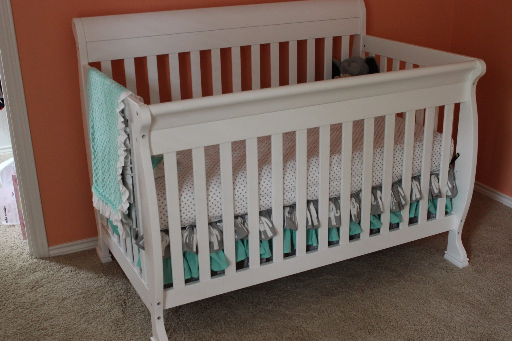 Coral and Mint Nursery Crib