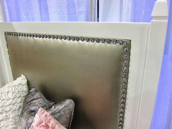 girl's twin bed with tufted headboard