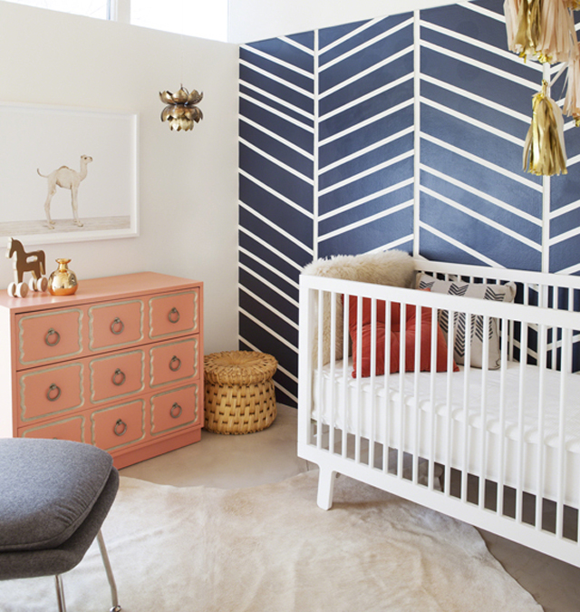 Nursery with Geometric Arrow-Inspired Accent Wall
