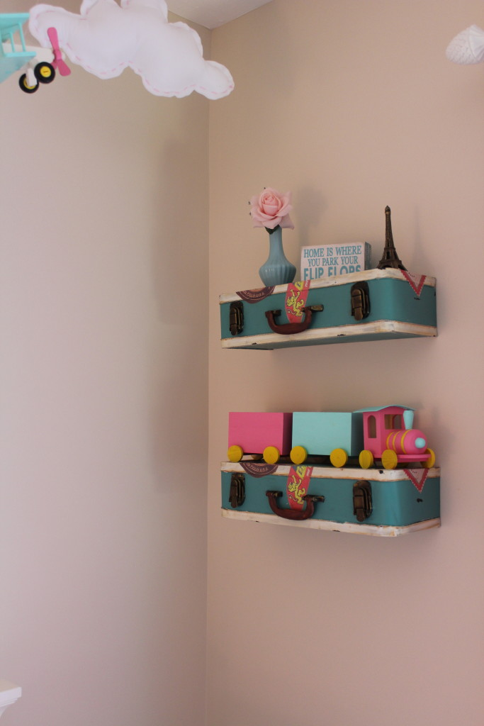 Suitcase Shelves in this Travel Themed Nursery