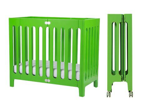 green mini crib