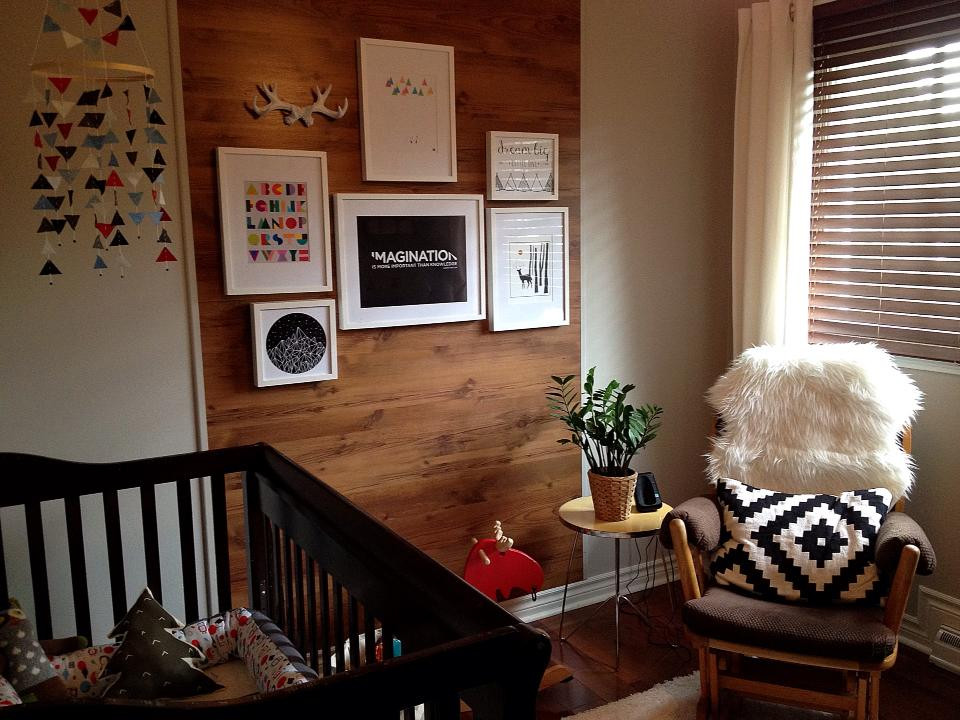 Boy's Woodland Nursery with wood wall and southwestern details
