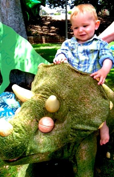 Dinosaur 1st Birthday Party Riding the Dino