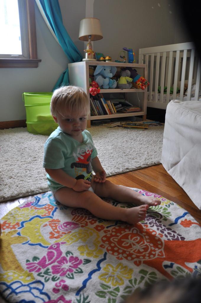 Gender-Neutral Nursery Boy on a Carpet