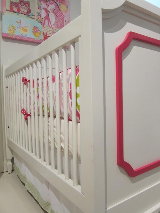 Hot pink and white baby crib