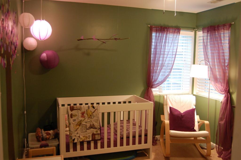 White Baby Crib and Ikea POÄNG Rocking Chair