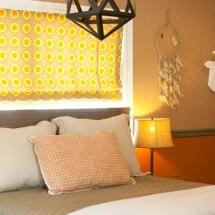 Orange and Brown Hunting-Inspired Bedroom with Mounted Deer Head - Project Nursery