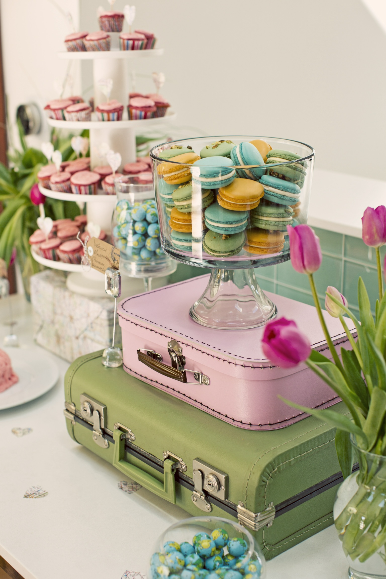 Stacked Suitcases and Colorful Macaroons