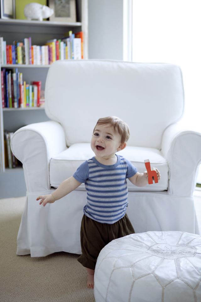 Casual Nursery with White Upholstered Glider and Pouf