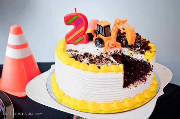 "Birthday Cake with Excavator ""Digging"" Out a Section"