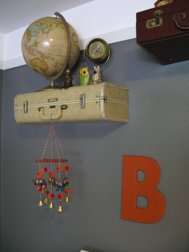 Vintage Globe Accent on Vintage Suitcase Shelves