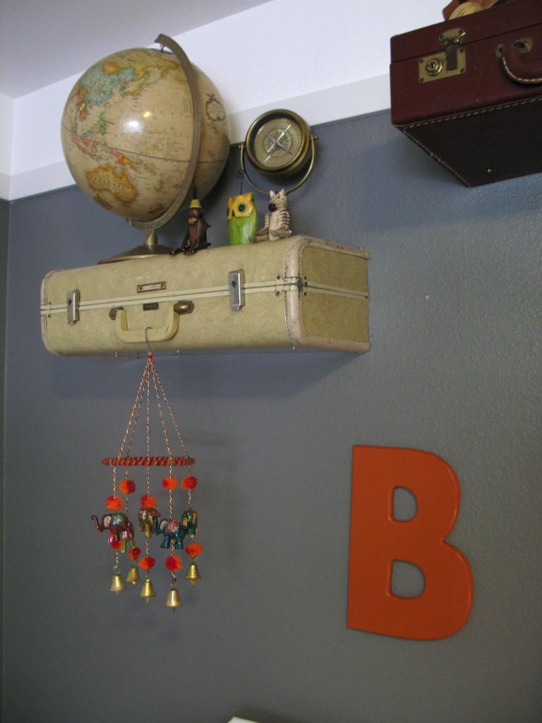 Vintage Globe Accent on Vintage Suitcase Shelves