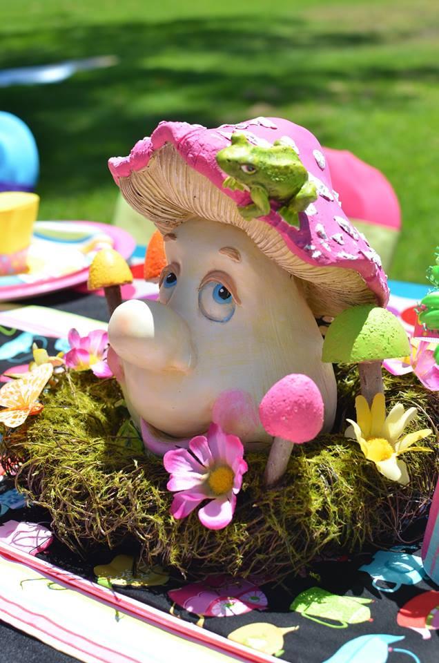 Mr. Mushroom Sits Happily Among Moss and Mushrooms