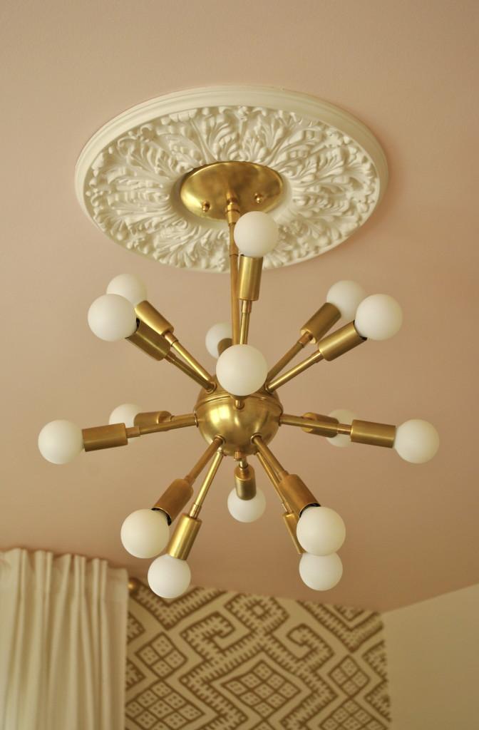 Gold Sputnik Light Fixture in this Artist Inspired Nursery