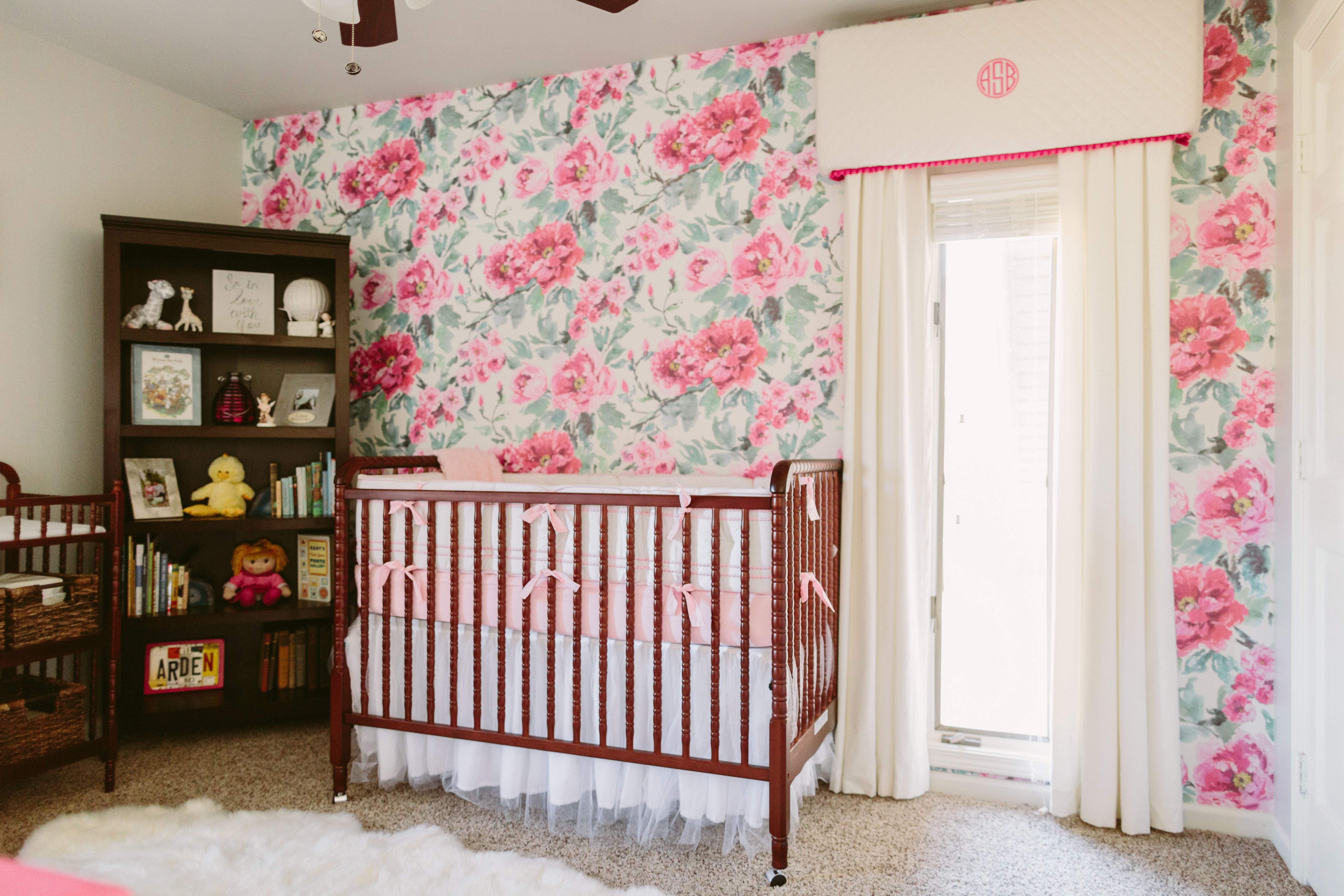 Bold Baby Girl Nursery with Floral Wallpaper