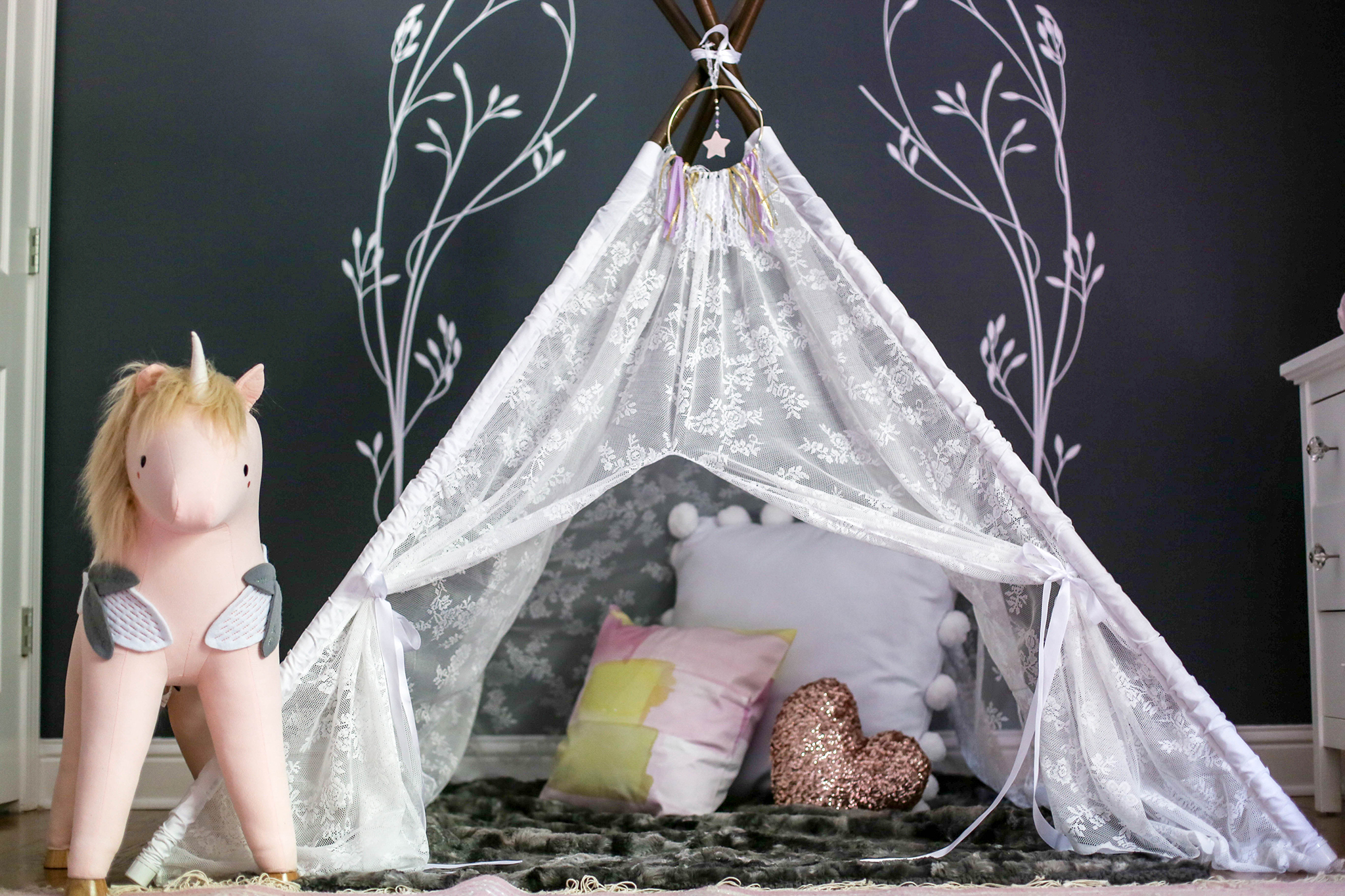Lace Teepee and Ride On Unicorn in Nursery