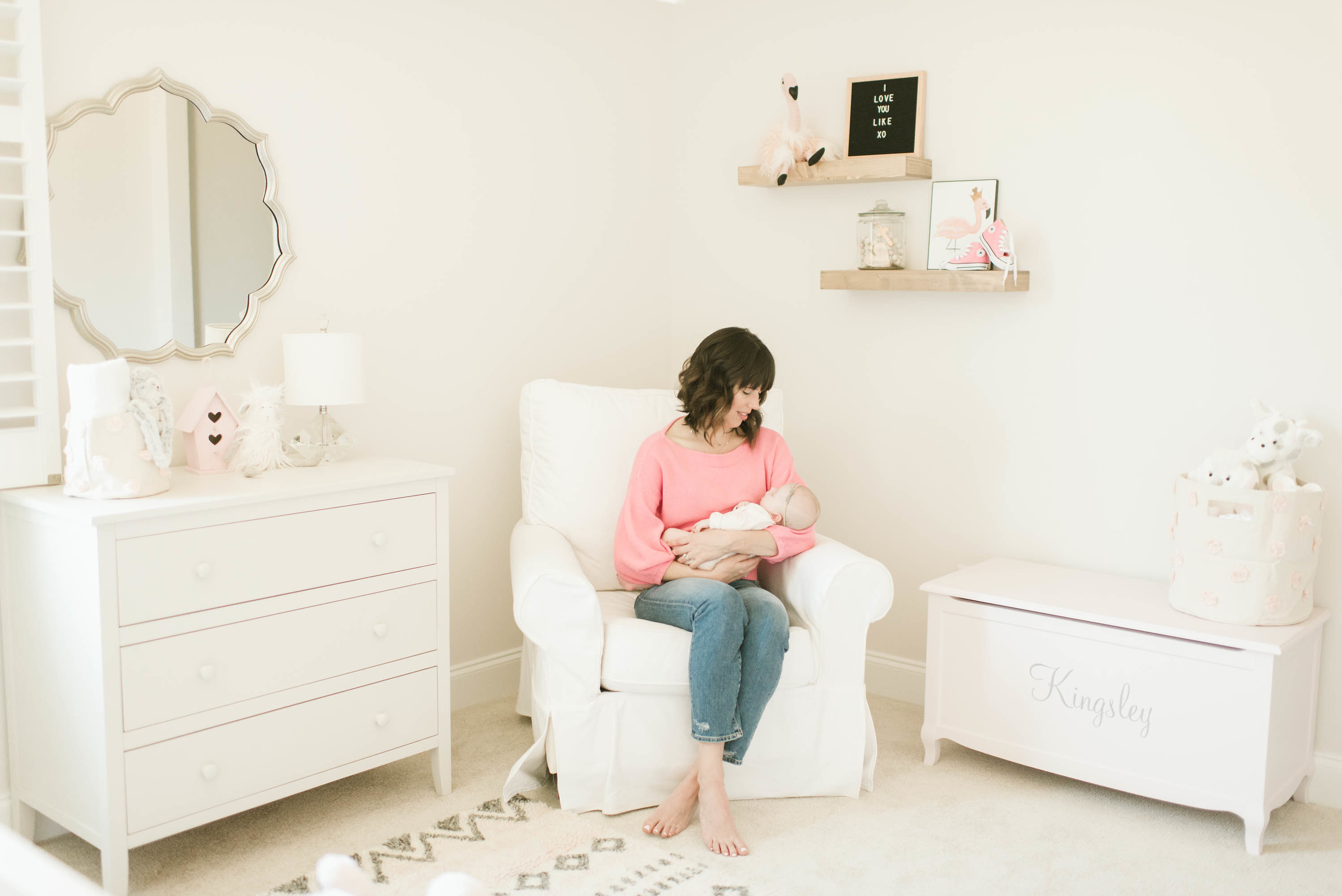 Glider Nook in Girl's White Nursery with Pink Accents