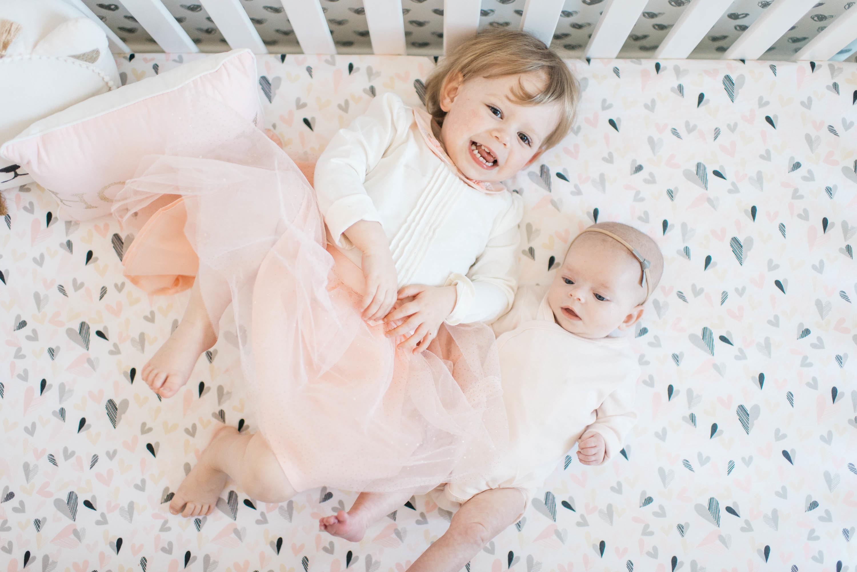 Sisters in Crib