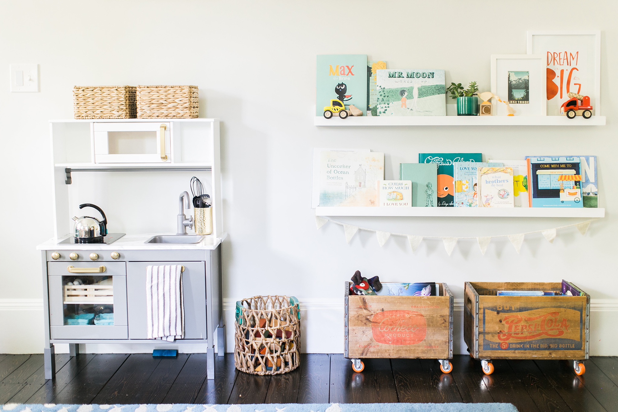 Play Kitchen and Book Storage in Playroom - Project Nursery