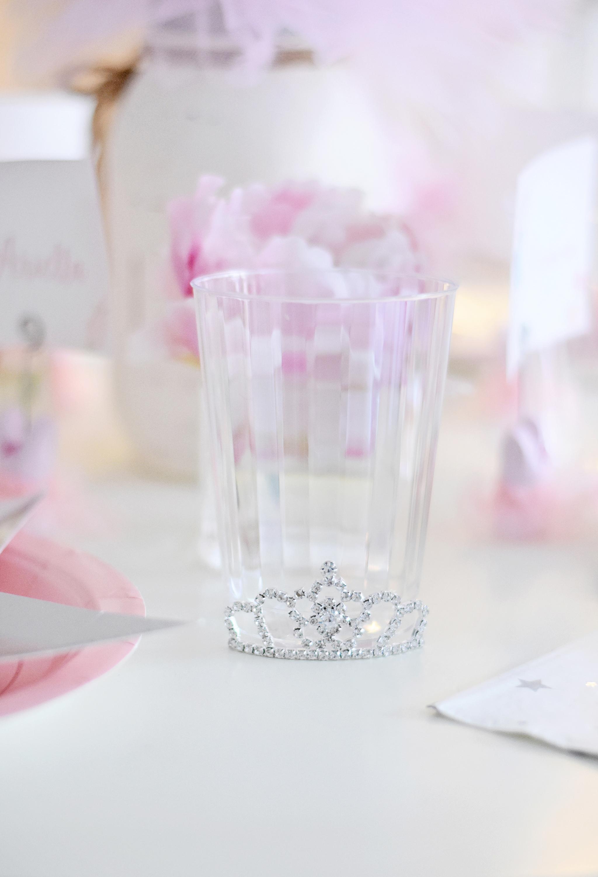 Glue a tiny tiara onto the bottom of a plain drinking glass!