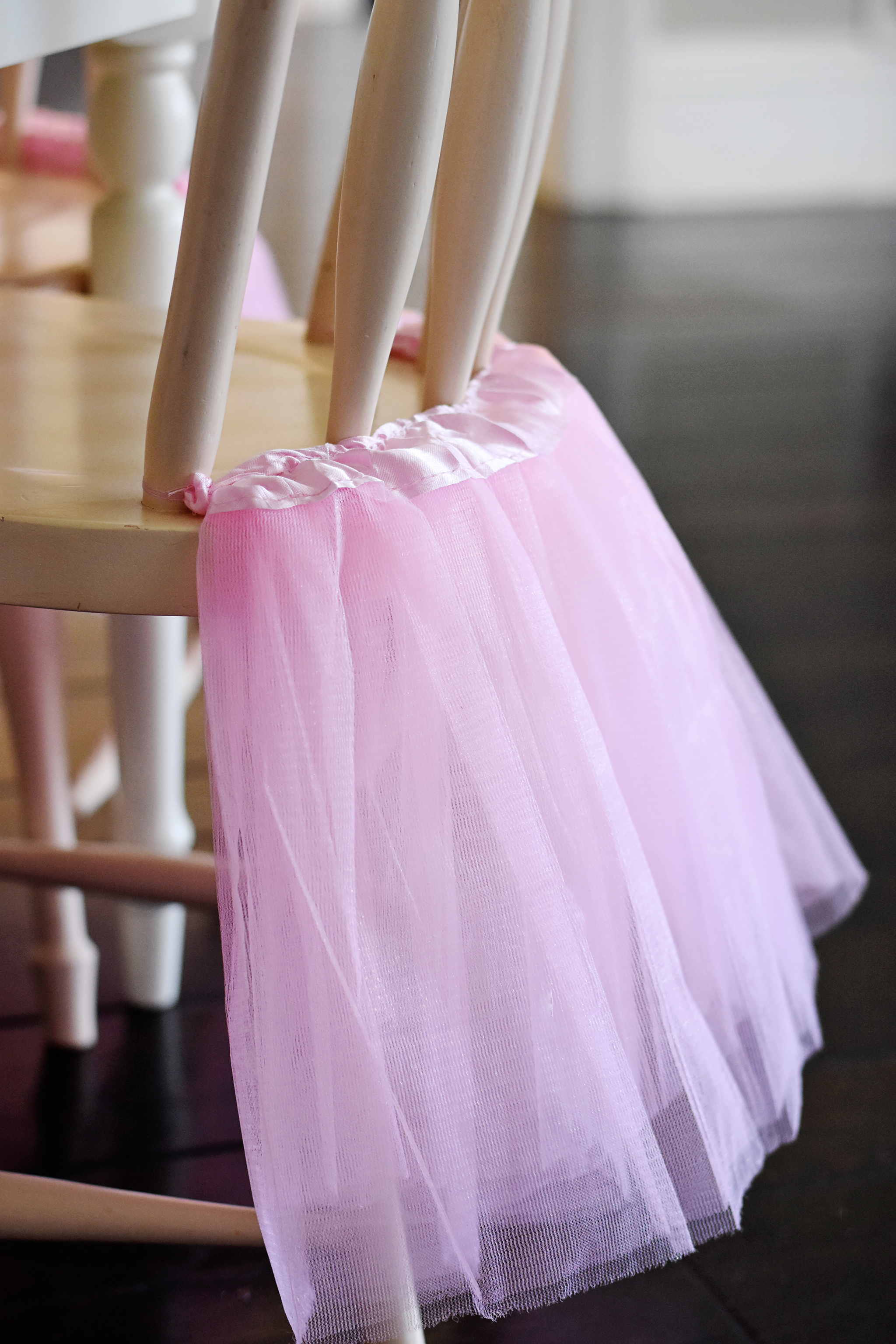 Dress up plain chairs with inexpensive pink tutu skirts!