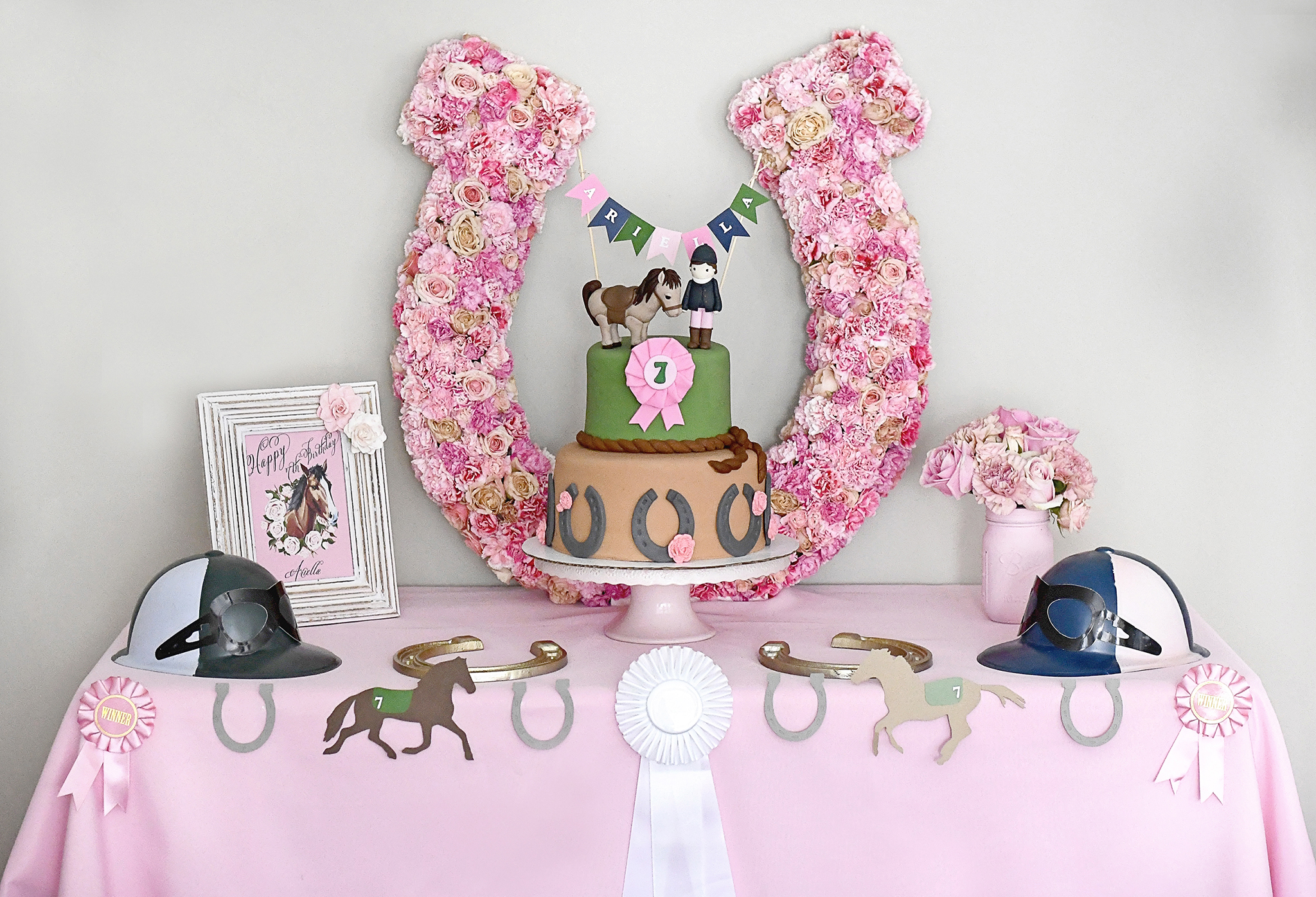 Horse-themed cake and fresh floral horseshoe cake backdrop!