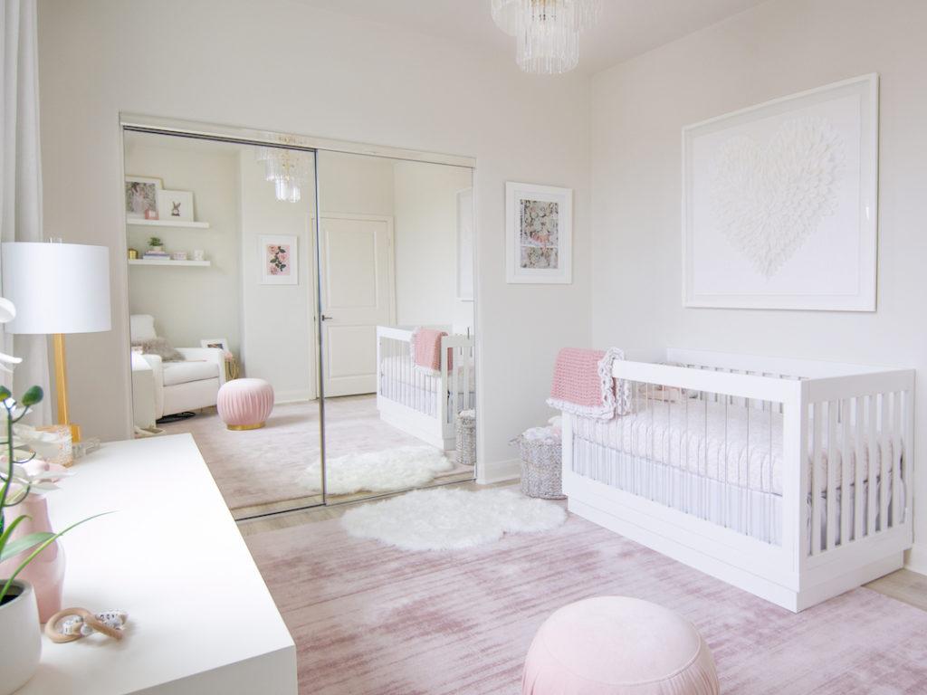 Modern Blush Nursery with Acrylic Decor by Little Crown Interiors