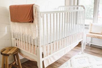 A Simple White Nursery In Small Bonus Room
