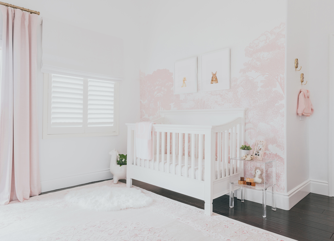 Pink Nature-Inspired Nursery with Pink Tree Mural and Acrylic Accents