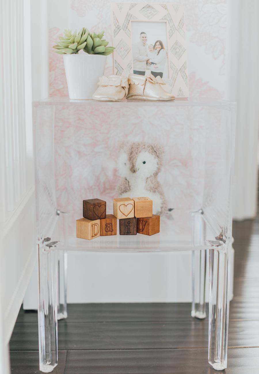 Acrylic Nursery Shelf Styling in Baby Girl Nursery