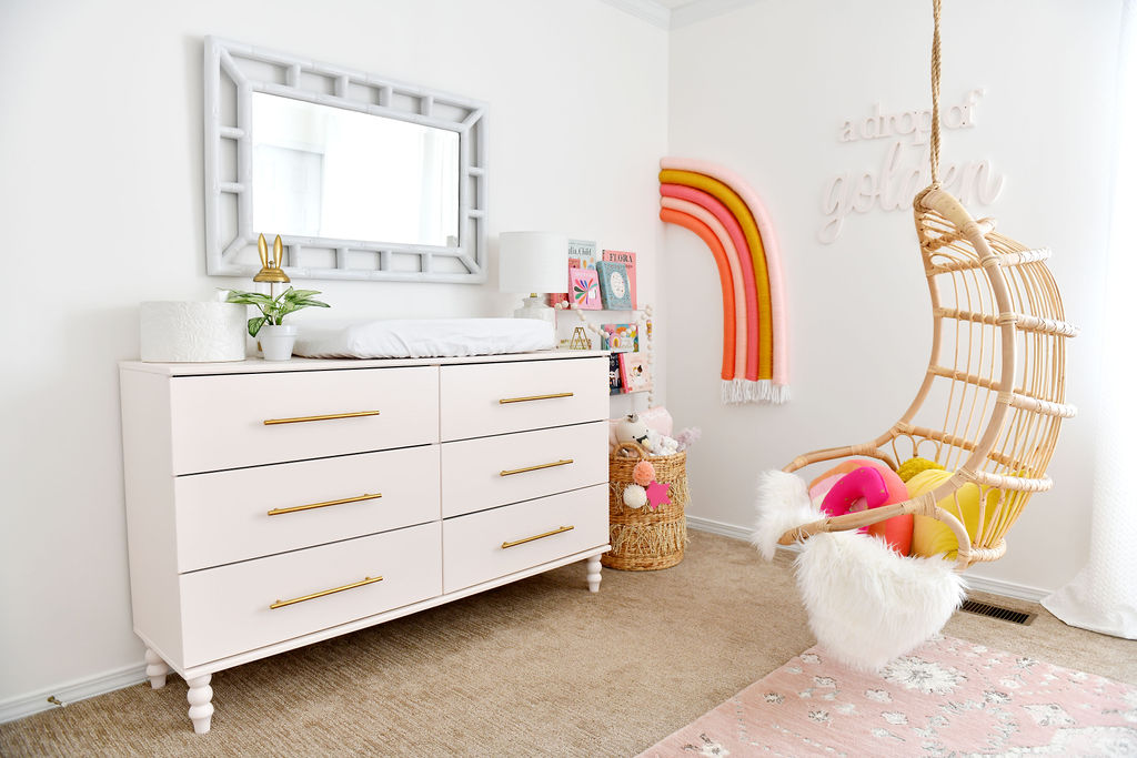 Rainbow Nursery with Hanging Rattan Chair and Pink IKEA Hack Dresser