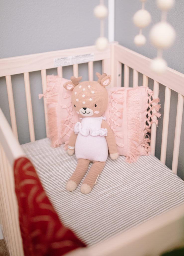 Cuddle + Kind Deer Doll in Natural Mini Crib with Striped Mini Crib Sheet