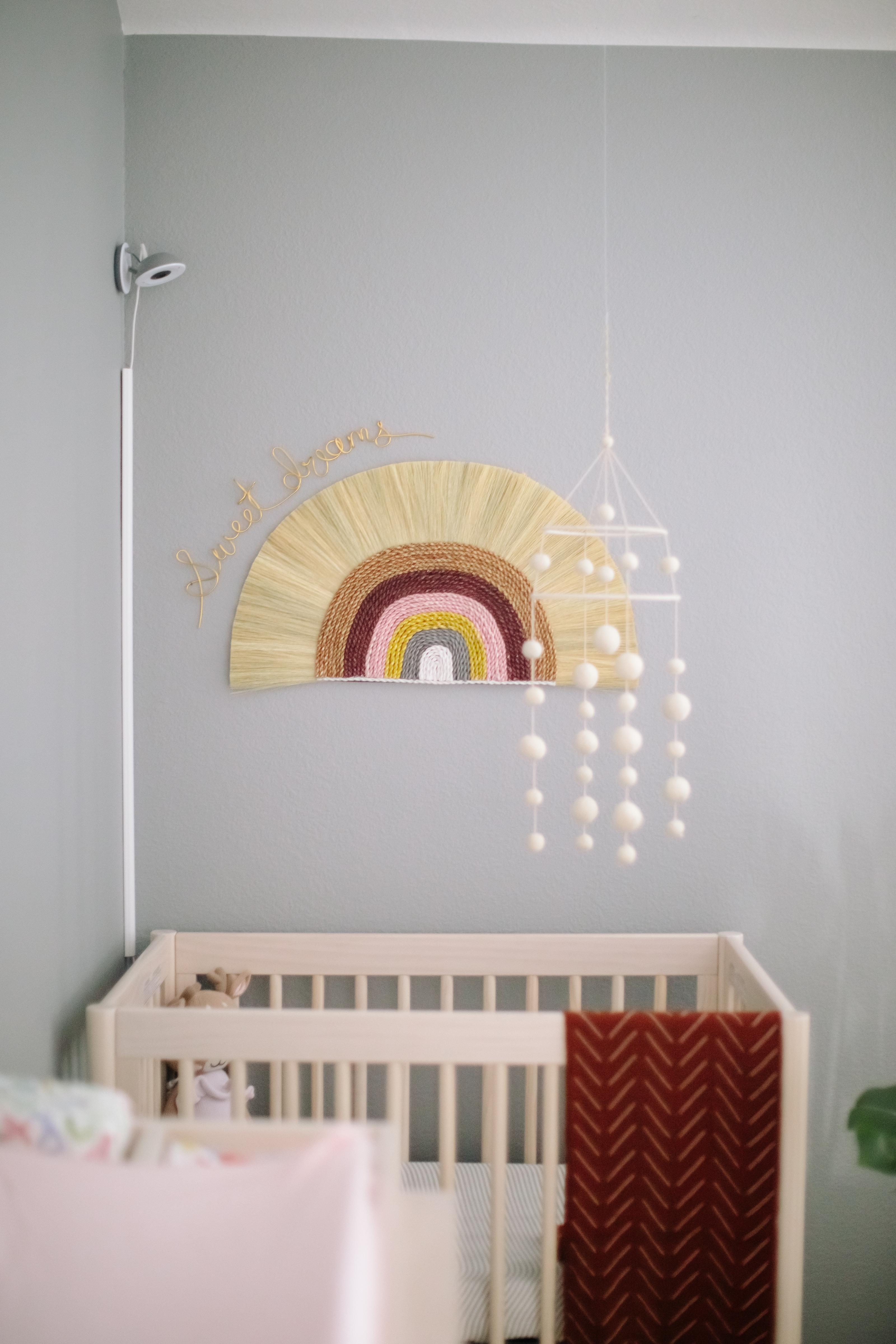 Boho Rainbow Wall Hanging with Felt Ball Mobile in Nursery Nook