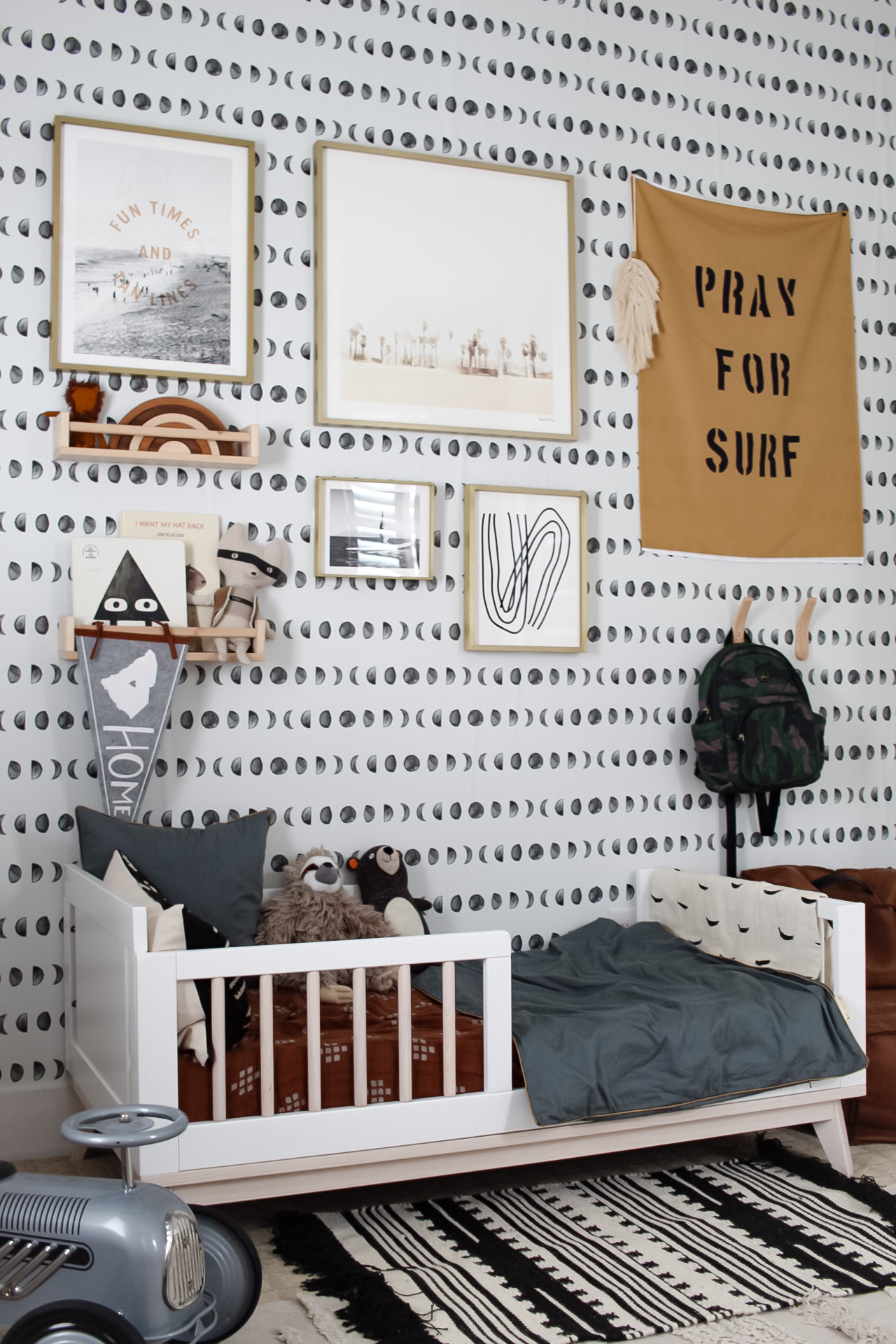 Toddler Boy Room with Graphic Wallpaper and Unique Art