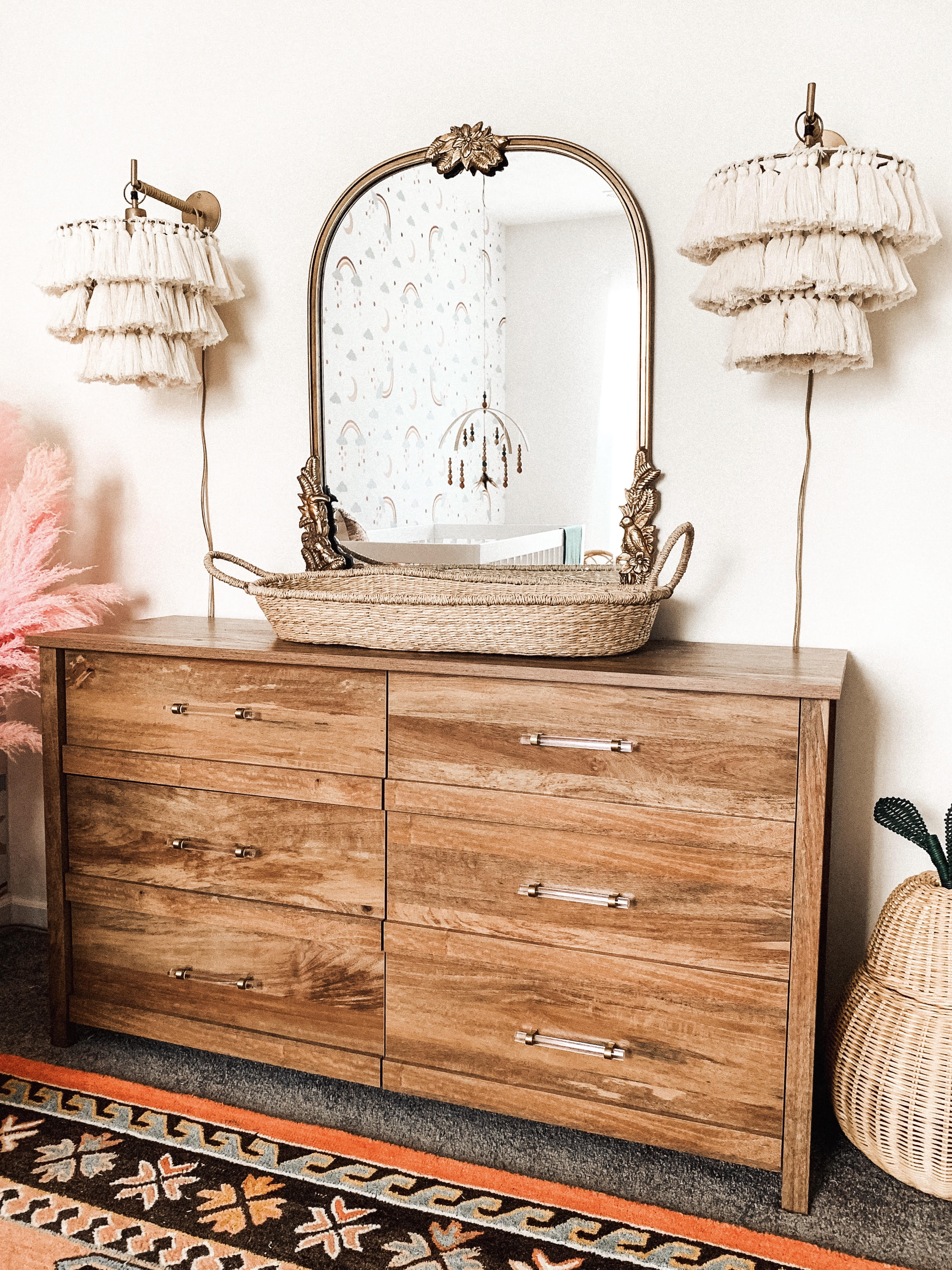 Wood Dresser with Changing Basket and Tassel Wall Pendants