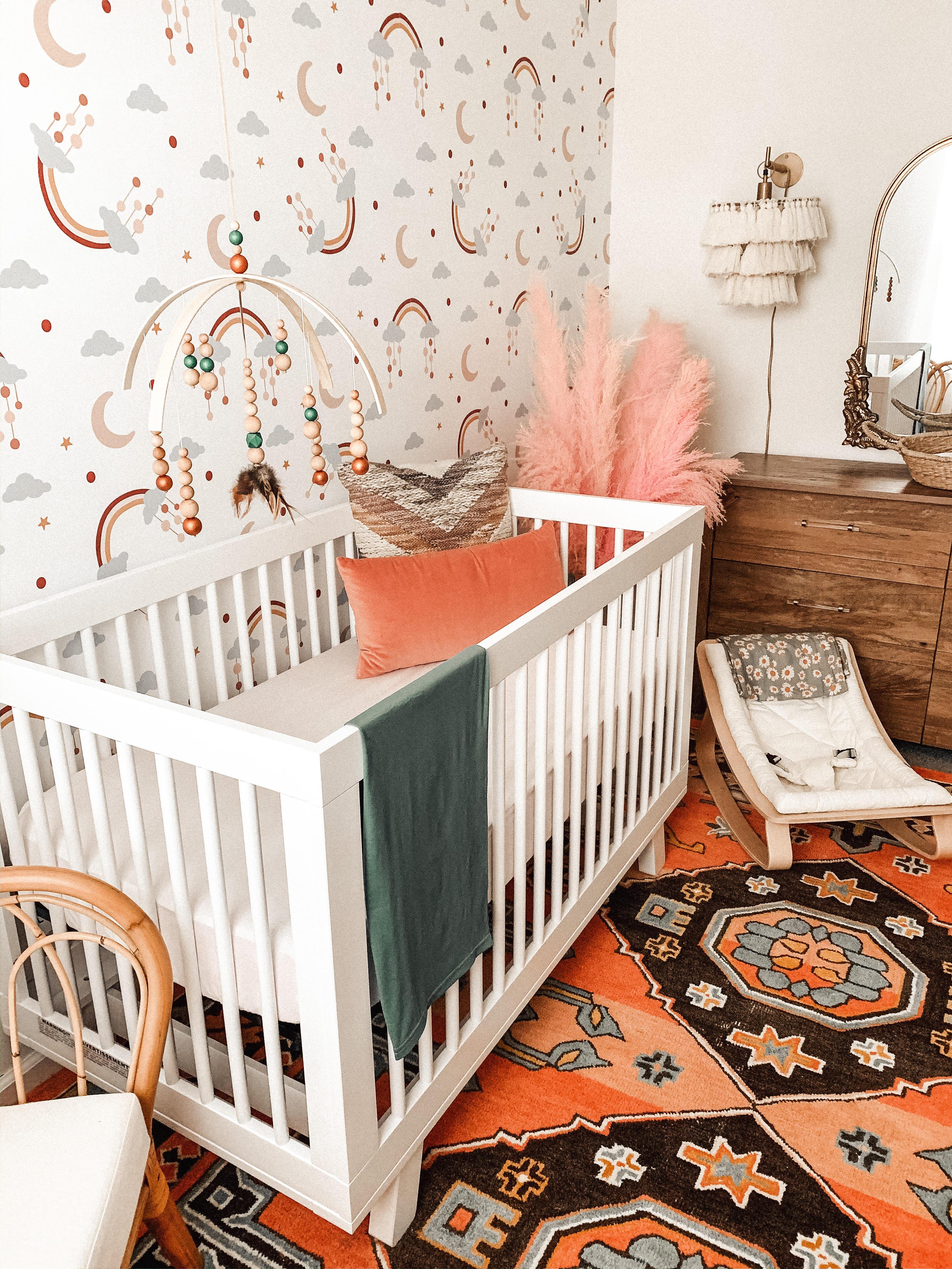Muted Rainbow Cloud Wallpaper in Baby Girl Nursery