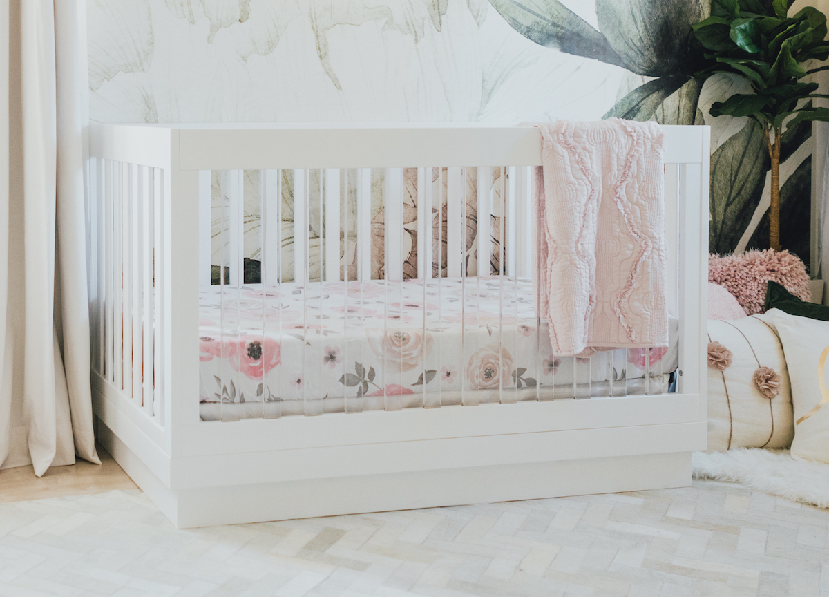 White and Acrylic Crib with Floral Wall Mural in Girls Nursery