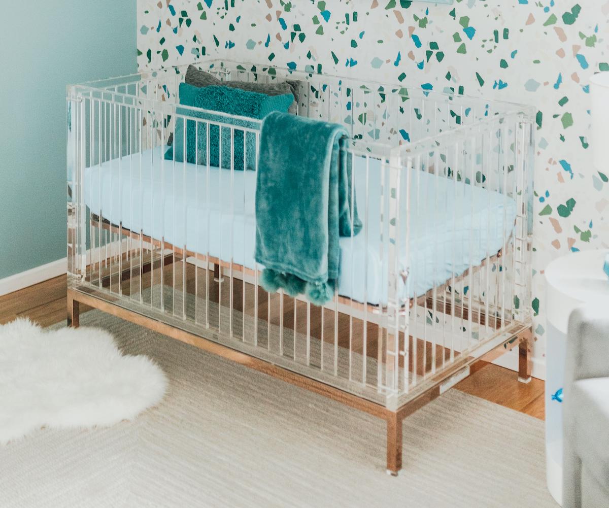 Acrylic Crib with Rose Gold Base in Teal Terrazzo Nursery