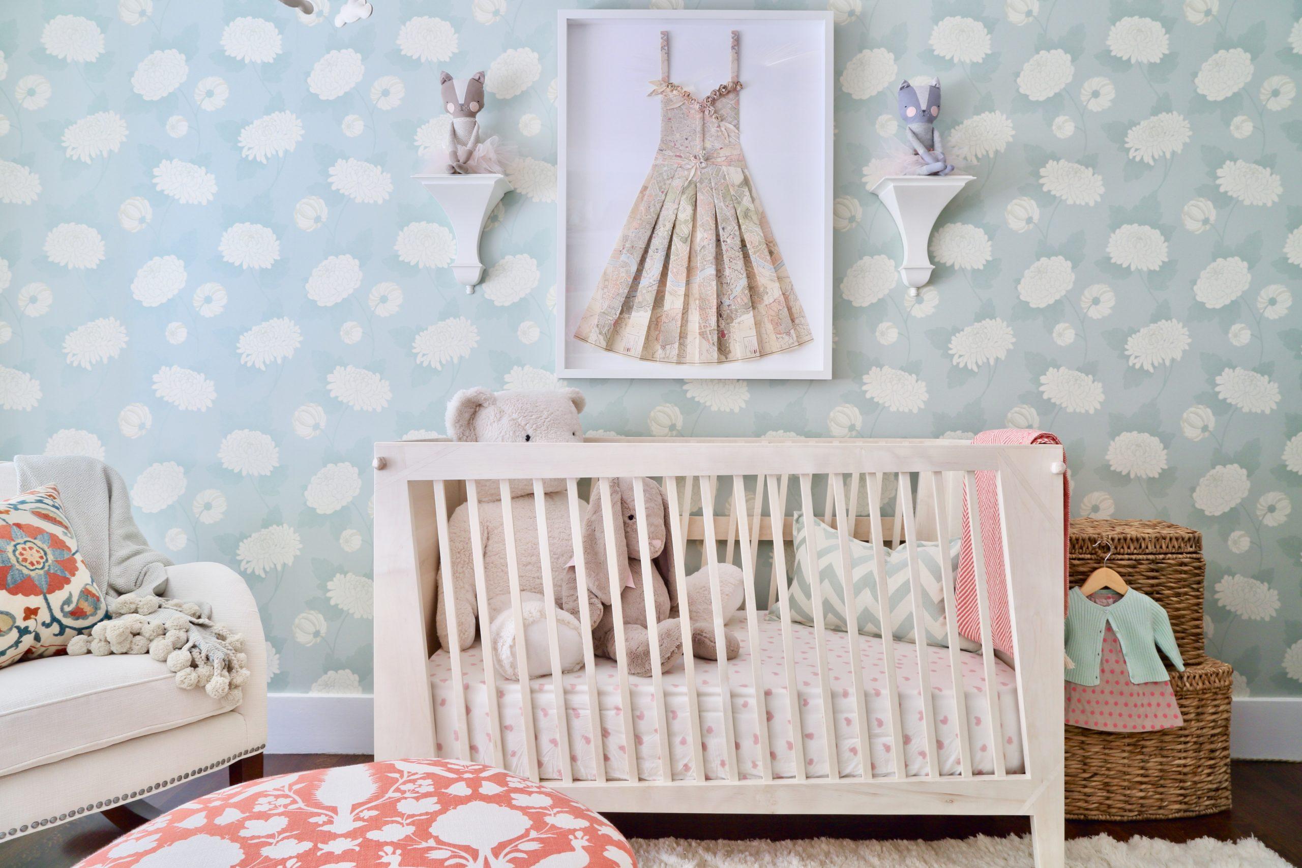 Whimsical Slanted Crib in Girl's Nursery with Folded Dress Art