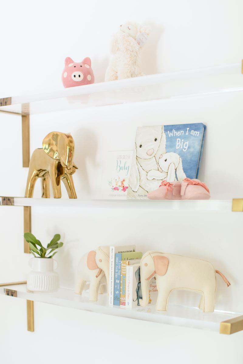 Acrylic Nursery Shelves in nursery by Little Crown Interiors